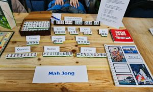 image shows examples of mah jong tiles on a table