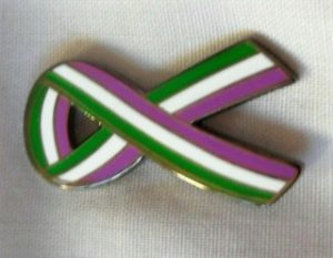 a green white and purple suffragette brooch