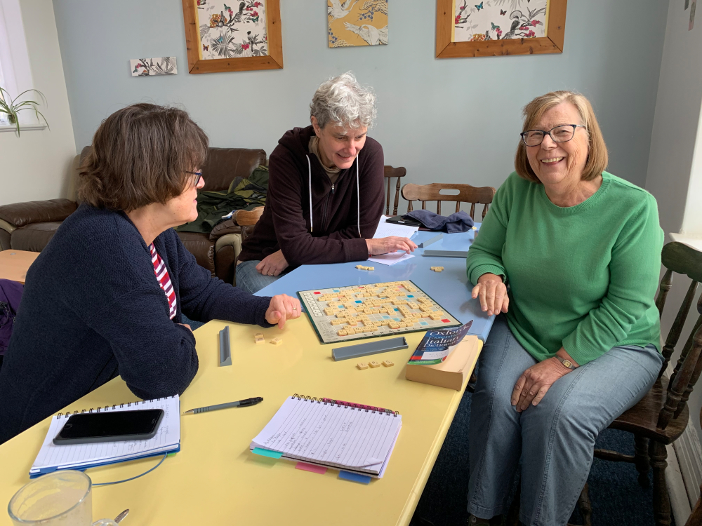 Image shows group members playing scrabble