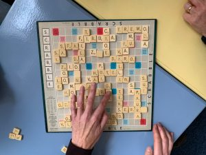 Image shows a Scrabble board being used in Italian language